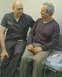 Consultant surgeon Doug Aitken (L) with Nic Mitchell