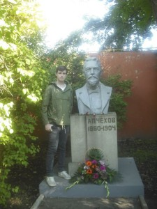 George, pictured next to a statue of Russian playwright Chekhov