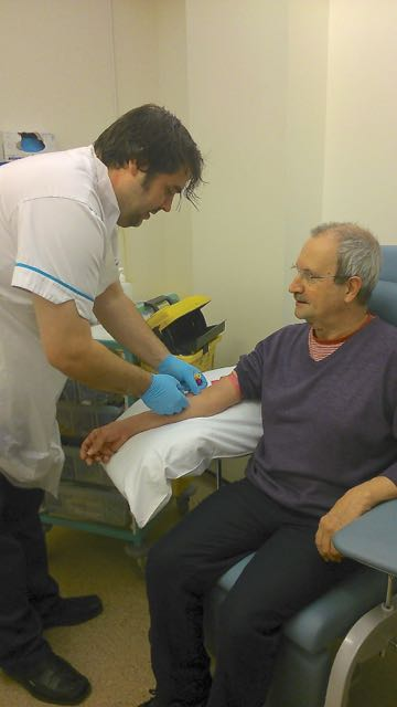 Phlebotomist Geoff Manders withdraws some blood from Nic